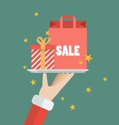 Santa Claus serving a present and shopping bag vector image vector image