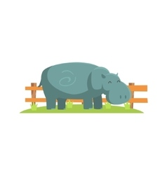 Relaxed grey hippo standing on green grass patch vector