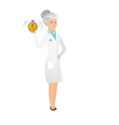 Senior caucasian doctor holding alarm clock vector
