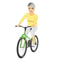 Happy senior woman riding bicycle vector