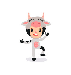 Cute kid character dressed as cow with horns vector