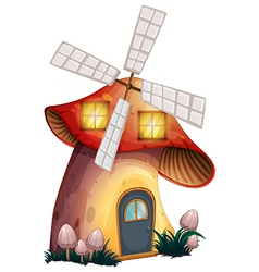 A mushroom house with a windmill vector