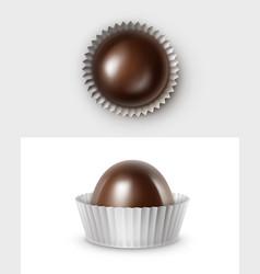 Dark black bitter chocolate candies in white paper vector