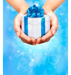 Hands holding gift boxes vector