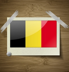 Flags belgium at frame on wooden texture vector
