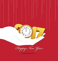 Happy new year 2017 hand holding a clock vector