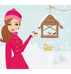 girl feeds the birds in winter vector image