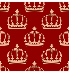 Seamless pattern of crowns on a red background vector image