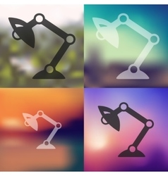 Desk lamp icon on blurred background vector