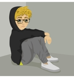 Teenager nerd boy desperate sitting on floor vector