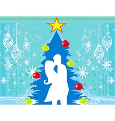 Couple kissing by a christmas tree vector