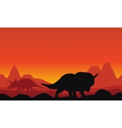 Silhouette of dinosaur triceratops with mountain vector