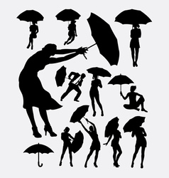 People with umbrella silhouette vector image