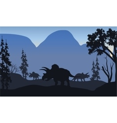 Triceratops of silhouette in hills vector