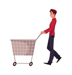 Young man buying products with a shopping cart vector image vector image