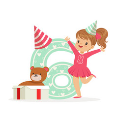 Adorable happy six year old girl in a party hat vector