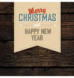 christmas tag vintage on hardwood planks vector image