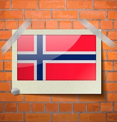 Flags norway scotch taped to a red brick wall vector
