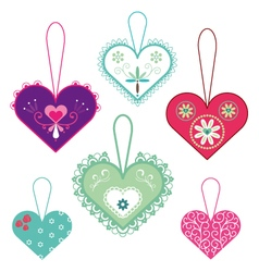 Decorative hanging hearts vector