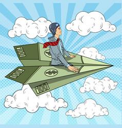 Pop art businessman flying on dollar paper plane vector