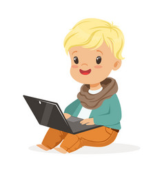 Cute little boy sitting and using laptop for vector
