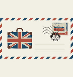 envelope with suitcase in colors of british flag vector image vector image