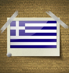 Flags greece at frame on a brick background vector
