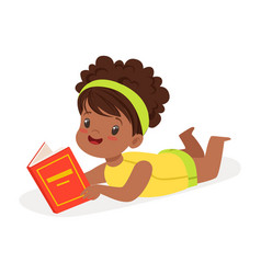 sweet african girl lying on the floor and reading vector image
