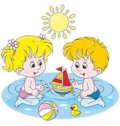 Children playing in water vector
