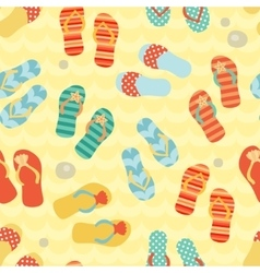 Seamless pattern with flip flops on a sand vector image