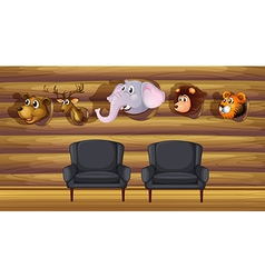 A living room with stuffed head decorations vector