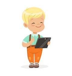 smiling little boy using digital tablet for vector image