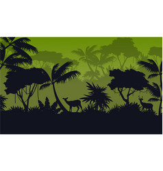 Forest scenery with deer silhouettes vector