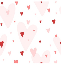 Seamless pattern with red and pink hearts vector