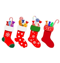 Christmas socks with candies vector