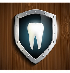 human tooth on the background of the shield vector image
