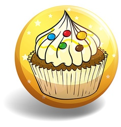 Cupcake on yellow badge vector