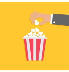 Popcorn and hand flat vector