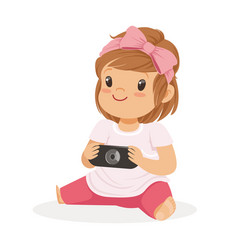 Cute little girl sitting on the floor and playing vector