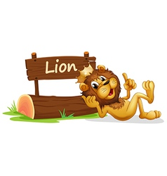 A lion with a crown relaxing beside a signboard vector image