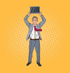 pop art businessman holding laptop above his head vector image