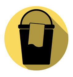 bucket and a rag sign flat black icon vector image