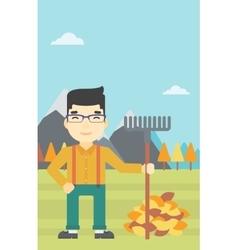 Man raking autumn leaves vector image