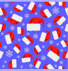 Red hat and snowflakes seamless pattern vector