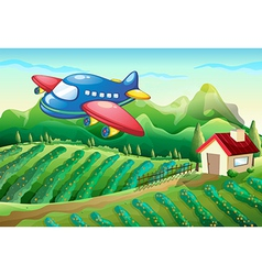 An airplane above the farm with a house vector image vector image