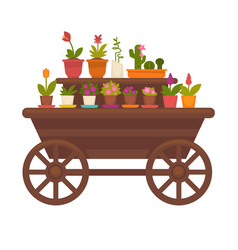 Fresh spring flowers in pots on wooden trolley vector