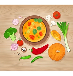Vegetable soup and ingredients on wooden backgroun vector