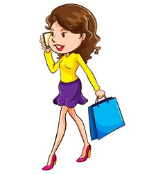 A girl using a mobile phone vector image