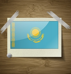 Flags Kazakhstan at frame on wooden texture vector image