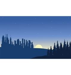 City and moon of silhouette vector
